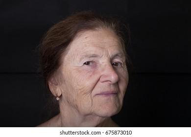 Portrait of elderly woman. Tricky glance.
