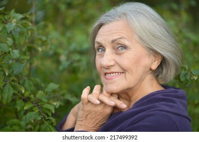 Portrait of  elderly woman walking in the park