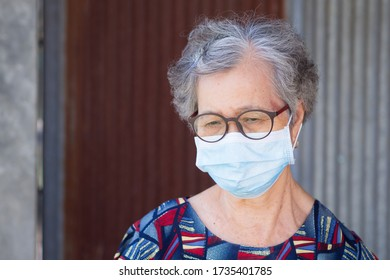 Portrait of an elderly woman wearing a face mask with a worried. Mask for protect virus, coronavirus, pollen grains. Concept of old people and healthcare.