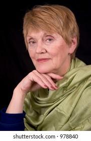 Portrait of an elderly woman wearing a green silk scarf
