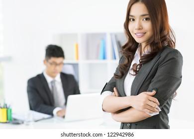 Portrait of an elegant business girl in office
