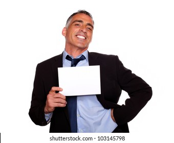 Portrait of a elegant executive man smiling and holding a white card with copyspace while having fun on isolated background