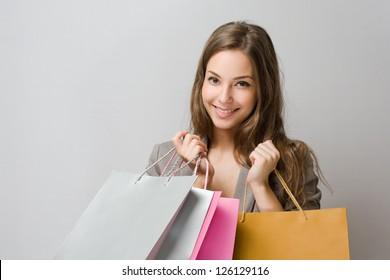 Portrait of elegant gorgeous young brunette shopper.
