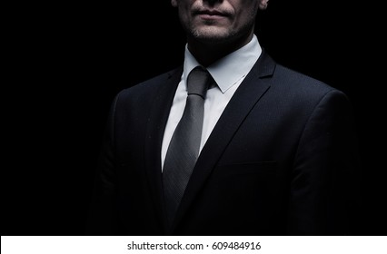Portrait of an elegant handsome business man isolated on black