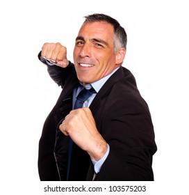 Portrait of a elegant latin broker man on black suit boxing against white background