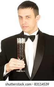 Portrait of the elegant man with a grape wine glass
