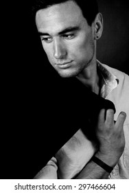 portrait of the elegant man on dark