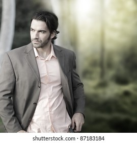 Portrait of elegant man in suit outdoors with lots of copy space