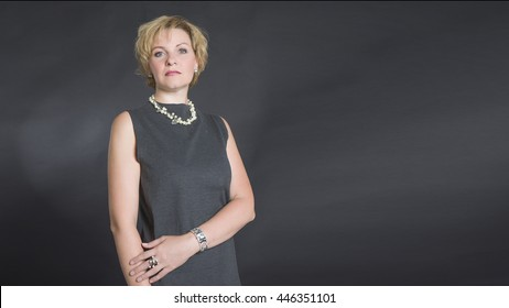Portrait of elegant middle aged woman.