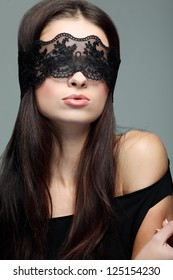 portrait elegant sexual  brunette woman is in a black lace mask