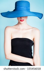 Portrait of elegant sexy woman with hat