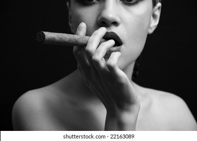 Portrait of elegant smoking woman. Fashion photo