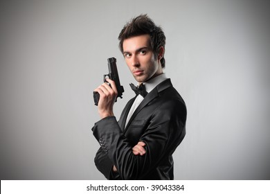portrait of elegant spy with gun
