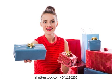 Portrait of elegant woman, giving a gift box. Isolated on white