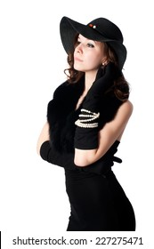 Portrait of elegant woman in hat and with beads. retro style