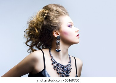 Portrait of elegant young blond girl. Profile view