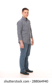 Portrait of elegant young handsome boy in full length. Man in  plaid shirt posing in studio.