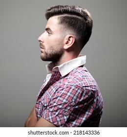 Portrait of elegant young handsome man. Studio fashion portrait.