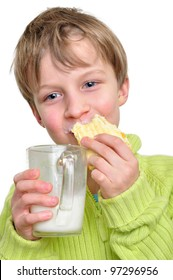 portrait of an elementary age boy eating cake and drinking milk