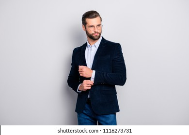 Portrait of elite elegant attractive dreamy fashionable groomed entrepreneur wearing dark blue velvet jacket checkered shirt correcting fixing cufflinks on sleeves isolated on gray background