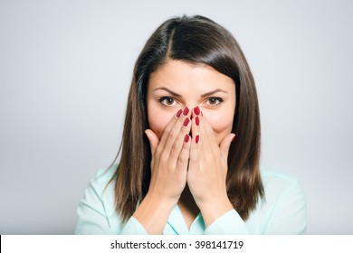 Portrait of a embarrassed young woman covers her face and
