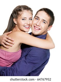 Portrait of embracing happy beautiful couple - white background