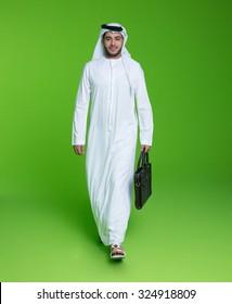 Portrait of Emirati businessman carrying bag