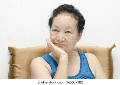 Portrait of emotion asian senior woman with toothache