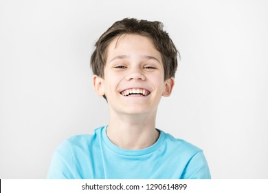 Portrait of an emotional boy on a white background.