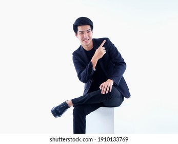 Portrait of emotional handsome man pointing over white background. Space for text