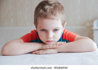 Portrait of emotional little boy at home