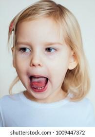 Portrait of emotional little girl. Happy blonde child