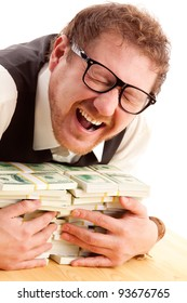 portrait of emotional man in glasses holding bundles of money isolated on white