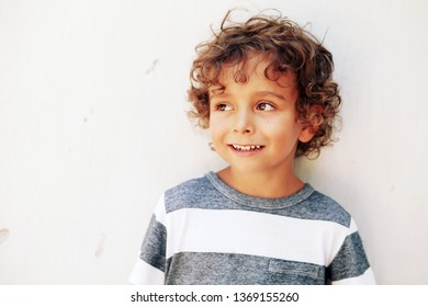 Portrait of emotionally kid. Funny little boy. Beautiful curly toddler