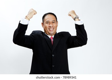 Portrait of a energetic mature businessman enjoying success against white - Isolated