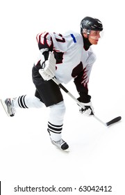 Portrait of energetic player playing hockey on ice