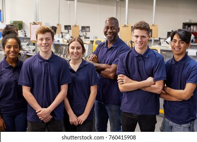 Portrait Of Engineer And Apprentices In Factory