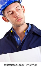 Portrait of an engineer looking at a scheme