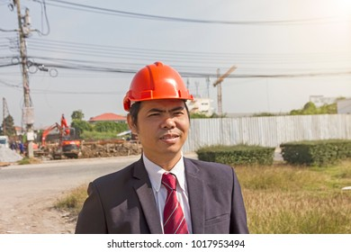 Portrait engineer people working with architecture at construction site as background.