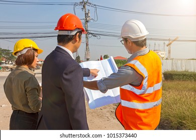 Portrait engineer people working and discussing with architecture at construction site and worker looking, using as background (concept of teamwork and partnership)