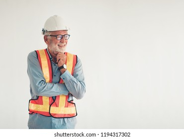 Portrait of an engineer senior posing crossed arms confident and happy with natural smile laughing.