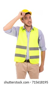 Portrait of an engineer smiling and wearing yellow vest and helmet, isolated on white background