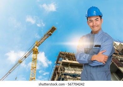 Portrait of engineer wear blue helmet safty on construction site with crane background