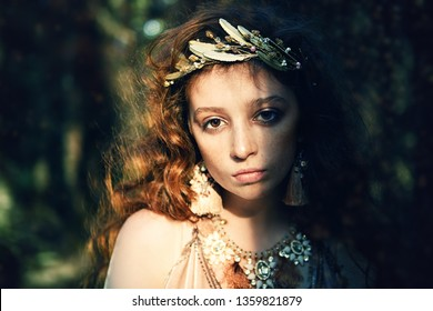 Portrait of an enigmatic beautiful girl posing in a forest. Beauty, fashion. Cosmetics and makeup. - Shutterstock ID 1359821879