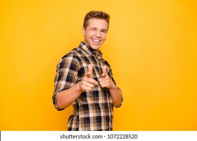 Portrait of enthusiastic attractive guy indicating on camera giving  wink isolated on vivid background