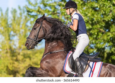 Portrait of equine sportswoman jumping on a horse.