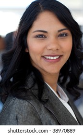 Portrait of ethnic businesswoman in office looking at the camera