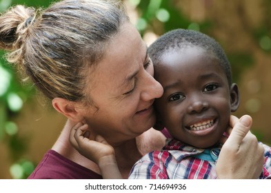 Portrait of European woman with a black African boy