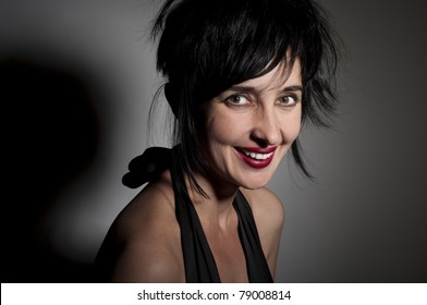 Portrait of evil looking gorgeous laughing woman