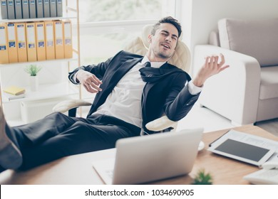 Portrait of excited adorable funny fun joy joyful emotional enthusiastic toothy with closed eyes entrepreneur boss chief employee playing on virtual guitar